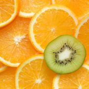 Image of fresh oranges with the kiwi that stands out from the rest